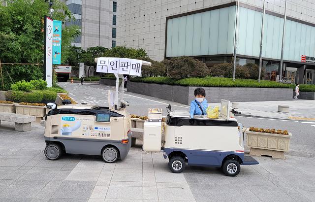 【韓國城市傳說】擁有高科技加成的 韓國養樂多阿珠媽 ! (+無人自動販賣車)